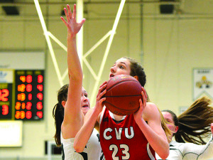 Shannon Loiseau makes her move to the hoop during the final minute of CVU's Division 1 Girls Basketball Championship game versus St. Johnsbury Academy on Saturday the 18th. CVU won it's fifth consecutive girls title.