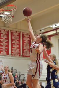 CVU's Marlee Gunn makes a layup during the girl's division 1 basketball quarter final match with Essex at CVU on Saturday 11th