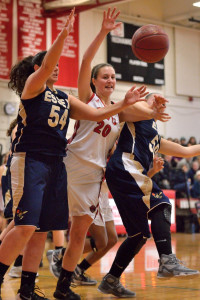 Lindsey Albertelli fights for a rebound between two Essex defenderss  during CVU's quarter final game versus Essex on Saturday the 11th in Hinesburg