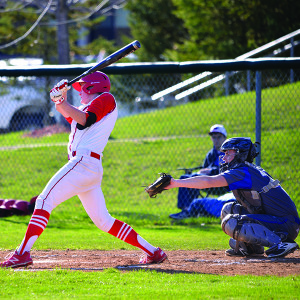 Pitcher, Liam Reiner, helps himself with a double during CVU's game with Colchester in Hinesburg on Tuesday the 18th.