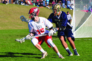 Sam Sturim tries to spin around his Essex defender at their lacrosse game on Tuesday the18th in Hinesburg.