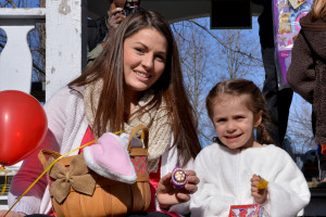 Mackenzie Sawyer (4) with Mom, Heather, shows off the first special prize egg at the Williston/Richmond Rotary Easter Egg hunt on Saturday morning the 15th