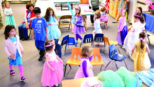 """Observer photos by Al Frey The assembled prince and princesses play musical chairs during the """"Royal Evening"""" held on Saturday, April 1st at the Williston Federated Church. The event was held by a Girl Scount Troop to raise money for a trip to Italy."""