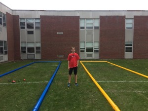 Observer courtesy photo Aidan Ruggles stands in the bocce court he helped build outside Williston Central School.