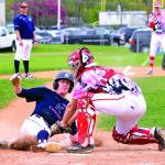 Jacob Bortnick tags out the Essex runner at home plate during CVU's game versus Essex on Saturday the 13th in Essex