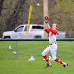 George Davis makes a running catch in center during CVU's game versus Mount Mansfield on Thursday, May 4th in Hinesburg.
