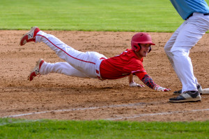 Colin Vincent dives safety back to first during CVU's game versus So Burlington on Friday the 19th in So Burlington.
