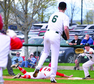Nate Shanks dives back into first base during CVU's game versus St Johnsbury on Saturday the 29th in Hinesburg