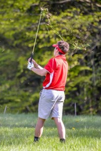 Observer photos by Al Frey CVU's Jack Caswell hits out of the deep rough during a boys golf tournament at Cedar Knoll with Rice, Essex and South Burlington