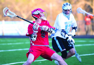 Max Akey gets off a shot on goal during CVU's game versus South Burlington on Wednesday evening, May3rd in South Burlington.