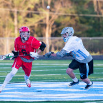 Jake Evans fights for the face-off during CVU's game versus South Burlington on Wednesday evening, May3rd in South Burlington.