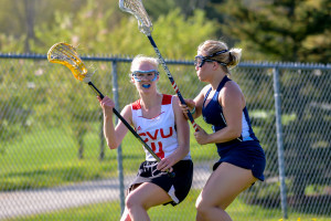 Kelsie Saia looks to pass from behind the net during CVU's game versus MMU on Tuesday May 16th in Hinesburg.