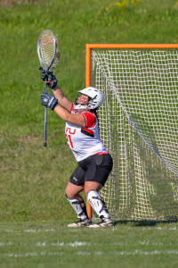 Ali Wainer makes a save during CVU's game versus MMU on Tuesday May 16th in Hinesburg.