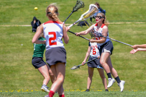 Mia Brumsted gets off a shot on goal during CVU's game versus Rice High School on Saturday May 20th in Hinesburg.