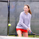 Sophie Dauerman makes a backhanded return during CVU's match versus South Burlington on a cool May 3rd, Wednesday evening in South Burlington