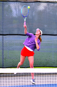 Renee Dauerman hits her serve during CVU's match versus South Burlington on a cool May 3rd, Wednesday evening in South Burlington