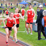 Sofia Gorman takes the baton for her leg of the 4x800 Relay on Wednesday the 10th in Hinesburg
