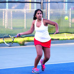 Stephanie Joseph lines up a forehand during CVU's Match with South Burlington on Wednesday, May 3rd in So Burlington.