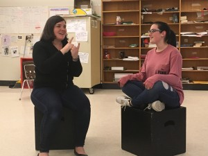 Observer contributed photo Elizabeth Pattison (left) and Emma Lieberman rehearse for 'Songs for a New World' at Champlain Valley Union High School. The show features deaf and hearing performers and plays this weekend at FlynnSpace in Burlington.