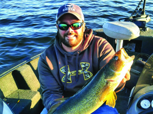 Observer courtesy photo Dylan Smith of Northfield shows off a Lake Champlain walleye he caught and released last June.