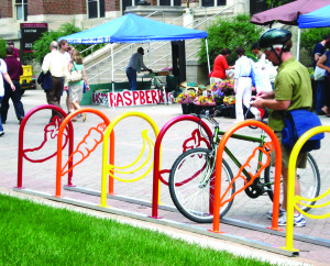 Observer courtesy photo Local Motion is offering free bike racks to businesses, schools and other organizations in the host towns of the once-planned Circumferential Highway through Chittenden County: Williston, Colchester and Essex.  The nonprofit alternative transportation advocacy group has approximately 75 hoop racks to extend to the community with a cap of two per organization.  Each rack is constructed of thick metal pipes and provides secure parking for up to two bikes. Local Motion asks that receiving organizations work with Local Motion to offer at least two of its bike skills workshops in exchange for the racks. Contact Local Motion at 652-2453 or visit localmotion.org for more information.