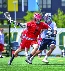 Xander Miller beats his defender to the inside during the boys D1 lacrosse championship at UVM's Virtue Field versus South Burlington on Saturday the 10th.