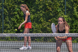 Kendall Blanck gets ready to serve. She and partner Meara Heininger finished second in the D1 girls doubles championship on Saturday the 27th.