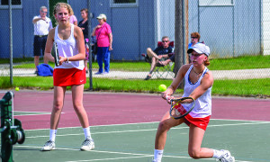 Doubles partners, Arielle DeSmet and Corina Gorman, win their match 6-0, 6-2 with South Burlington's duo during the girls D1 tennis championship in Shelburne on June 9th.