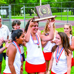 CVU Captains, (L to R) Stephanie Joseph, Maddie Huber and Meara Heininger receive the championship trophy at the girls D1 tennis championship in Shelburne on June 9th.