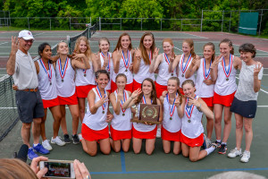 The CVU girls celebrate their three-peat at the girls D1 tennis championship in Shelburne on June 9th.