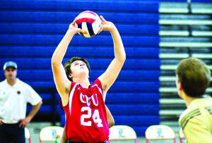 CVU's Jeffery Boliba sets the ball on Sunday during an all star game against New Hampshire.