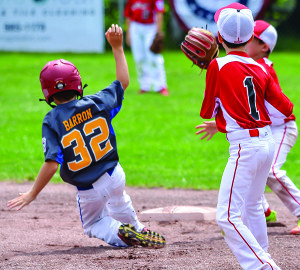 Mason Barron slides safely into second during the Williston Little League 9-10 All Stars game with Shelburne on Sunday the 9th.