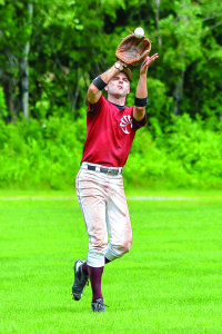 Williston Armadillos' center fielder and player/manager, Reid Crosby makes a nice running catch during their game versus Waterury on Sunday the 23rd. The Armadillos won the game and are in 3rd place in the league.