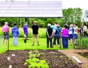 Chapin Kaynor (green cap) discusses his solar array and it's advantages during the Williston Sustainability Solutions Tour on Saturday the 8th.
