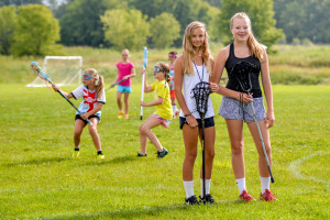 WCS 8th Graders, Sidney Mast (L) and CHloe Snipes (R) are giving instruction in lacrosse to a group of 4th and 5th grade girls for their 8th Grade Challenge Project.
