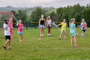 WCS 8th Graders, Chloe Snipes (Center L) and Sidney Mast (Center R) are giving instruction in lacrosse to a group of 4th and 5th grade girls for their 8th Grade Challenge Project.