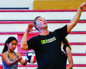 First year varsity coach, Mike Detch, keeps his girls moving during a recent volleyball practice.