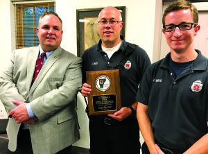 Observer photo by Jason Starr From left, Dan Batsie of the Vermont Department of Health and Williston firefighters Keith Baker and Prescott Nadeau mark Williston's designation as a HeartSafe Community on Tuesday at the police station.