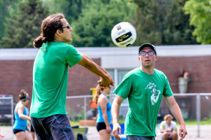 Philip Roy (playing the ball) and partner, Kevin Earle (hat) compete in the Greeen Mountain Volleyball tournament on Sunday at WCS