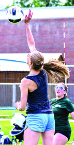Elizabeth Akin spikes the ball while partner MacKenzie McGuire looks on during the Greeen Mountain Volleyball tournament on Sunday at WCS