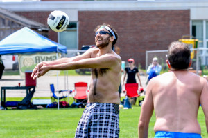 Josh Auerbach bumps the ball while partner Tim Archambeau looks on during the Greeen Mountain Volleyball tournament on Sunday at WCS