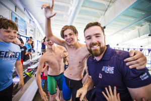 EDGE's Alex Ulanov celebrates with Head Coach Caleb Hall-Potvin following the announcement of their first place finish at the Vermont Swim Association Championships in Hartford on Sunday.