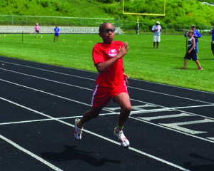 Champlain Valley's Jaden Griffith-Gomez competes July 29 in the boys 11-12-year-old 200-meter race at the annual Vermont Recreation and Parks Association's youth state track meet.