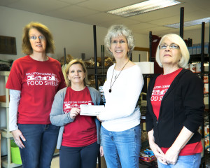 Observer courtesy photo (From left) Marija Claussen, Jennifer Selwah, Lynn Clauer and Nancy Leonard mark a $350 donation to the Williston Community Food Shelf raised during a weekly yoga class in Richmond.