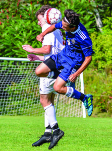 CVU's Jonah Roberts competes for a header  during CVU's game vs Essex on Saturday in Hinesbuurg.