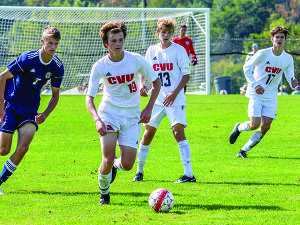 Luke Morton looks to pass the ball forward  during CVU's game vs Essex on Saturday in Hinesbuurg.