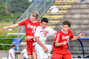 CVU's 's Nate Godboutr (#20 on the left) gets his head to the ball during the CVU vs Rutland game on Saturday evening in Essex.