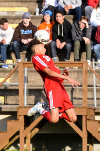 CVU's Oliver Martin leaps high to play the ball during CVU's game vs Rutland on Saturday in Essex.