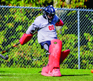 CVU's Kristy Carlson makes a kick save during CVU's game vs Colchester on Saturday