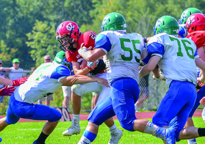 Shane Boehmke fights for yardage during CVU's game vs Colchester on Saturday in Hinesburg.